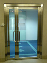 Wooden doors glass doors thick clear tempered double leaves glass doors fitted with floor spring mechanism 1800mm length stainless steel door handles and complete with wooden planetlyrics Choice Image